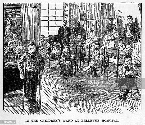 A scene in the children's ward at Bellevue Hospital showing children some on crutches or with legs in casts and nurses in the room New York City late...