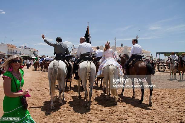 Scene in the village, riders, pilgrims, horses of the Hermandad of Huelva leaving the Hermitage of El Rocío, Almonte, Huelva.