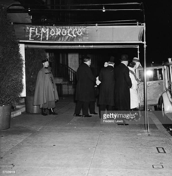 Scene of a group of people leaving New York City's popular night club 'El Morocco' circa 1935