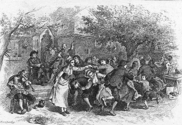 A scene of Acadians as they dance and frolic to a fiddler's...