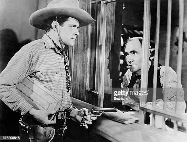 A scene of bank robbery from an unidentified movie with Donald Woods as the robber