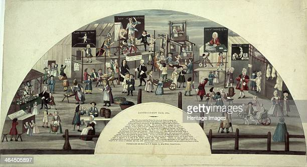 Scene of Bartholomew Fair, 18th century. There are various market stalls and stages of entertainment. A man in a harlequin costume can be seen on the...