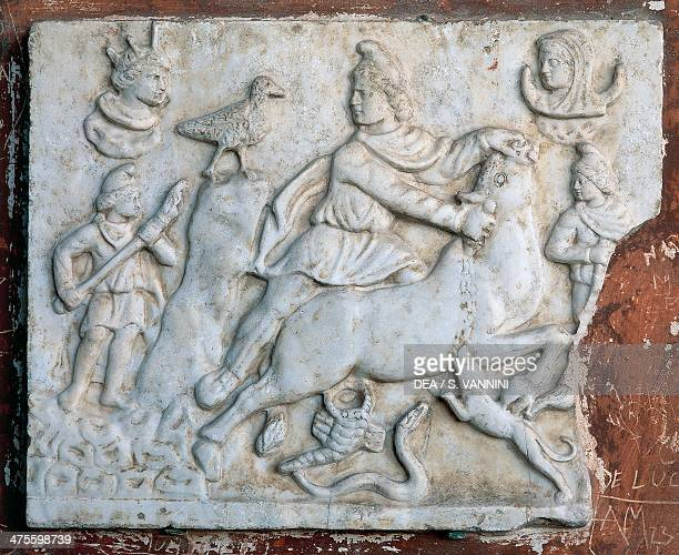 Scene of bullfighting Mitra surrounded by snake scorpion dog eagle and young people wearing Phrygian caps taming the bull relief in marble Monumental...