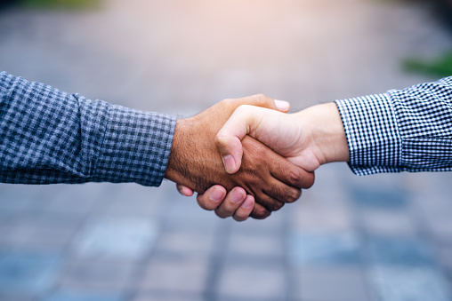 Scene of businessman handshake in outdoors - gettyimageskorea