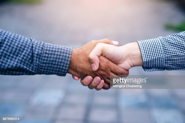 scene of businessman handshake in outdoors - respekt stock-fotos und bilder