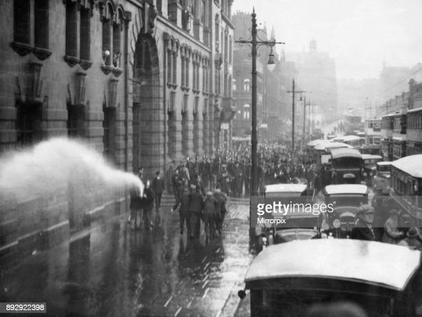 A scene of chaos and confusion as firemen turn the hose on a demonstration of unemployed workers organised by the National Unemployed Workers...