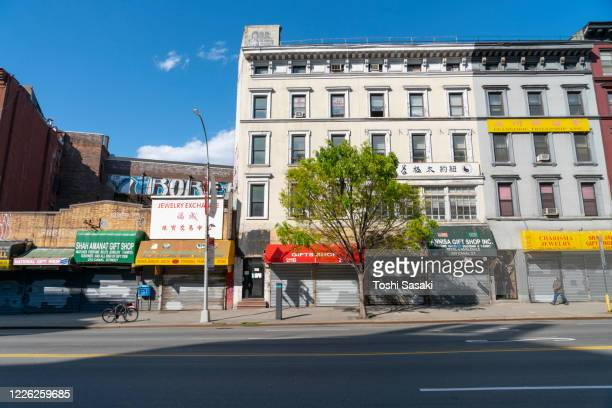 scene of china town district along the canal street during the quarantine for new york state on pause order of covid-19 at new york ny usa on may 7 2020. - canal street manhattan stock pictures, royalty-free photos & images