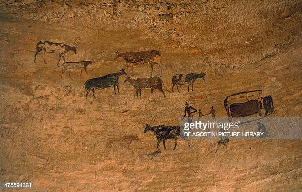 Scene of daily life with livestock rock art Tassili n'Ajjer Algeria Neolithic