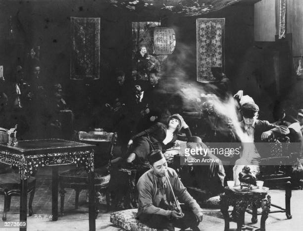 Scene of debauchery in an opium den from the film 'Broken Blossoms', directed by D W Griffith for United Artists. The film was alternatively titled...