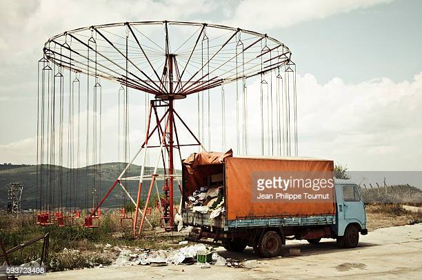 Scene of decay, an old merry-go-round and a truck in Kosovo