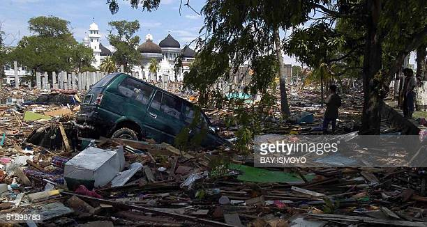 A scene of devastation surrounds the Baiturrahman mosque in Banda Aceh 27 December 2004 after a devastating quake and series of tidal waves struck...