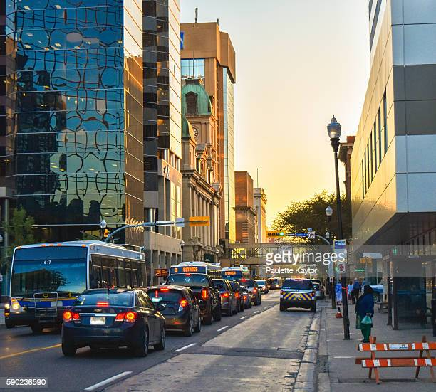 scene of downtown street with traffic in evening - regina saskatchewan stock pictures, royalty-free photos & images