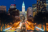 Scene of George Washington statue oand street in Philadelphia over the city hall with cityscape background at the twilight time, United States of America or USA, history and culture for travel concept