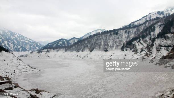 Scene of Kurobe dam between Snow wall at Tateyama Kurobe Alpine Route, Japan