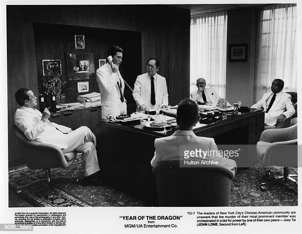 A scene of leaders of New York City ChineseAmerican community gather in an office from the MGM/UA movie 'Year of the Dragon' circa 1985