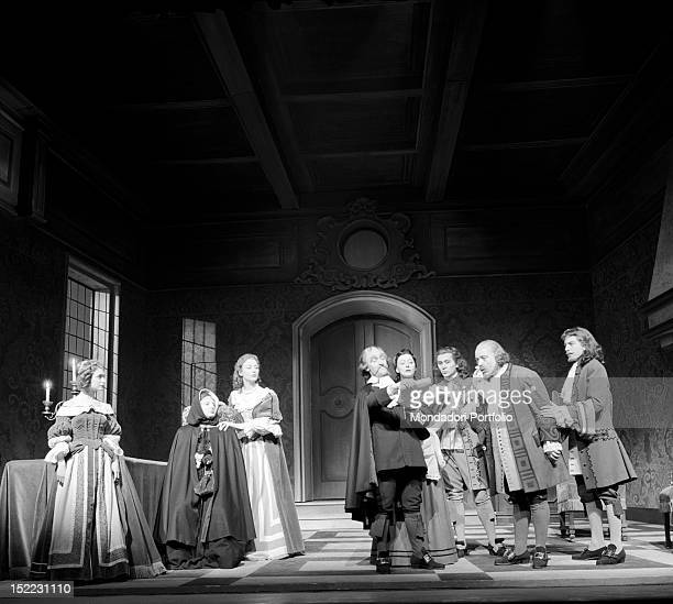A scene of 'Tartuffe' by Molière performed at the Manzoni Theatre an official is reading the charges against Tartuffe who is not on the stage Elmire...