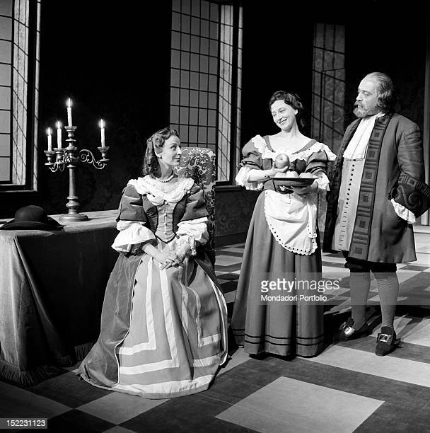 A scene of 'Tartuffe' by Molière performed in the Manzoni Theatre the actress Isa Barzizza is sat down and is smiling to Lilla Brignone under the...