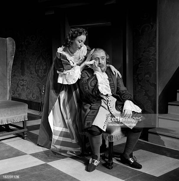A scene of 'Tartuffe' by Molière performed in the Manzoni Theatre the actor Glauco Mauri is sat on an armchair and is comforted by Isa Barzizza Milan...