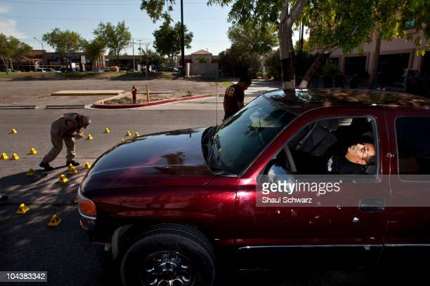 Scene of the crime A red pickup truck sprayed with bullet holes and three young dead men found inside in the parking lot of a shopping mall August 3...
