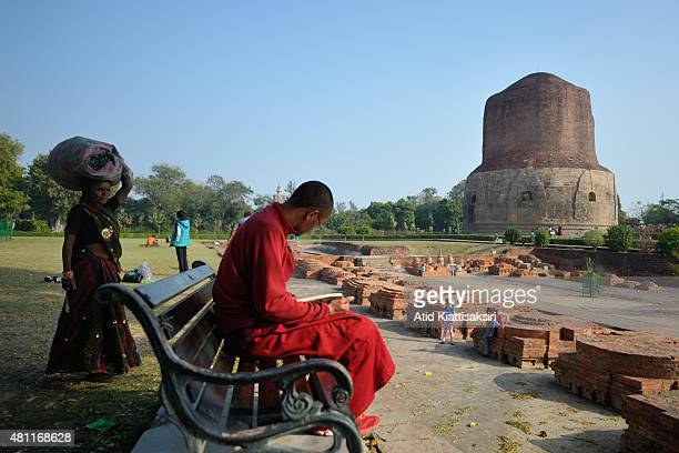 A scene of the Dhamekh Stupa with Indian people at Sarnath The Dhamek Stupa was built in 500 CE by king Ashoka along with several other monuments to...