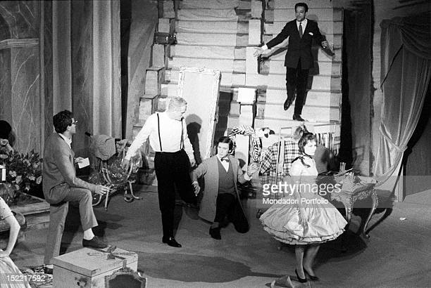 A scene of the play 'Un marziano a Roma' with Vittorio Gassman in the centre of the stage and other actors Teatro Lirico Milan November 23 1960