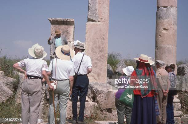 Scene of Western tourists observing the ancient columns at the ruins of Palmyra, northeast of Damascus, Syria, June 1994.