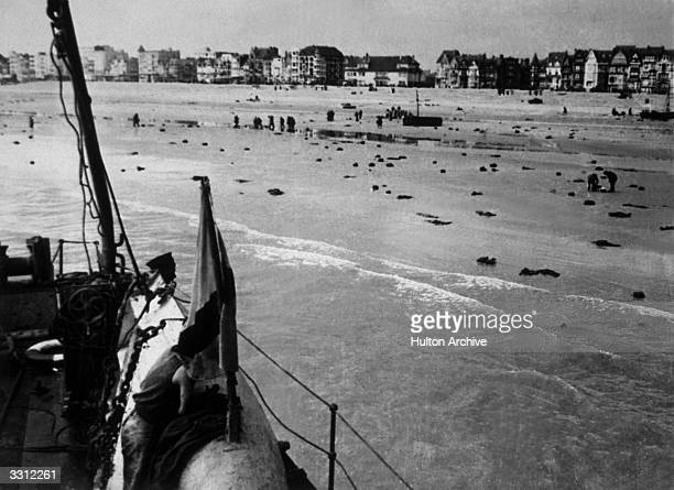 A scene on the beach at Dunkirk after a Nazi attack on French and British troops Many men threw their coats and equipment onto the sand before...