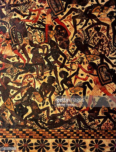 A scene painted on the side of a casket of Tutankhamun depicting a battle against the Nubians This detail shows wounded or dead Nubian soldiers and...