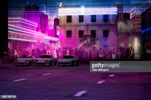 A scene playing out during the 'Fast Furious Live' technical rehearsal featuring cars from the show created by London based Feed The Fish that are...
