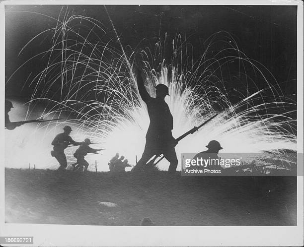 A scene showing US troops silhouetted against exploding phosphorus shells during World War One circa 1918 The scene is likely to have been staged...