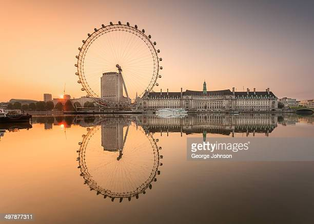 CONTENT] Scene shows the EDF Energy London Eye at dawn The still calm reflection in the River Thames just as the sun rises
