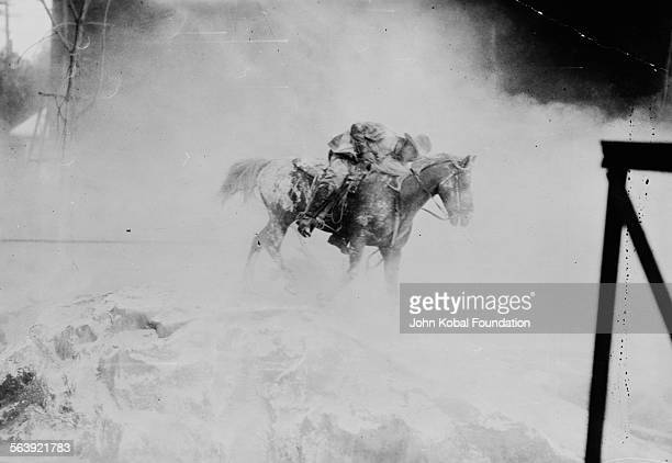 A scene with an actor on horseback from the film 'The Squaw Man' directed by filmmaker Cecil B DeMille for Jesse Lasky Feature Play Co 1914