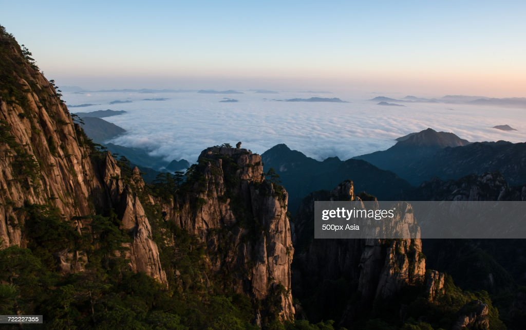 Scenery of mountains with steep cliffs at sunset mount huangshan scenery of mountains with steep cliffs at sunset mount huangshan anhui china voltagebd Images