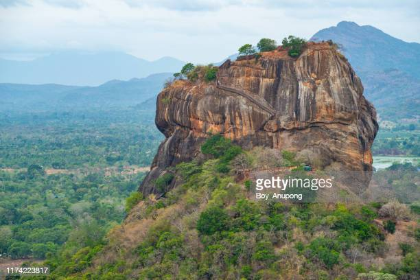 scenery view of sigiriya rock (lion rock) an iconic tourist destination and one of unesco world heritage site in sri lanka view from the top of pidurangala rock the sacred hill. - unesco stockfoto's en -beelden