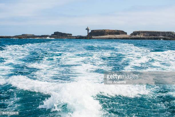Scenery view of The Seal rocks in Phillip Island of Australia. View from the travel boat.