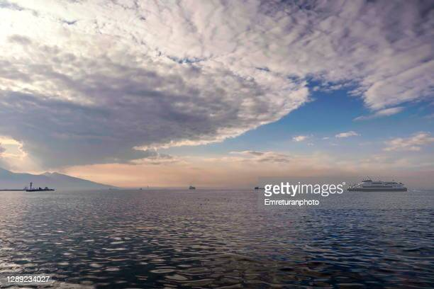 scenery with ships in izmir bay at sunset. - emreturanphoto stock pictures, royalty-free photos & images