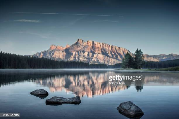 scenery with two jack lake and mountain in distance, banff national park, alberta, canada - image stock pictures, royalty-free photos & images
