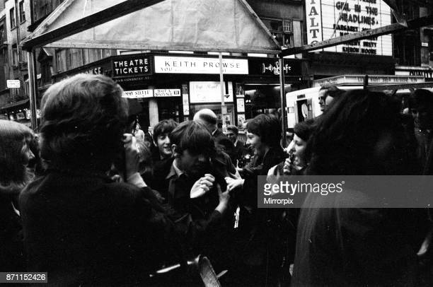 Scenes at The Prince of Wales Theatre in London when The Beatles arrived at the front entrance today for rehearsals of the Royal Variety Command...