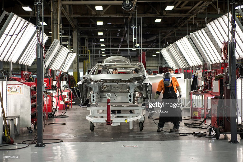 JANUARY 23, 2015. Scenes at the Tesla car factory include ...