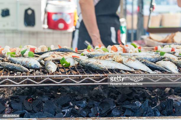 PORTUGAL TORONTO ONTARIO CANADA Scenes from Taste of Little Italy festival Fishes being cooked on a barbecue grill at a street stall Taste of Little...