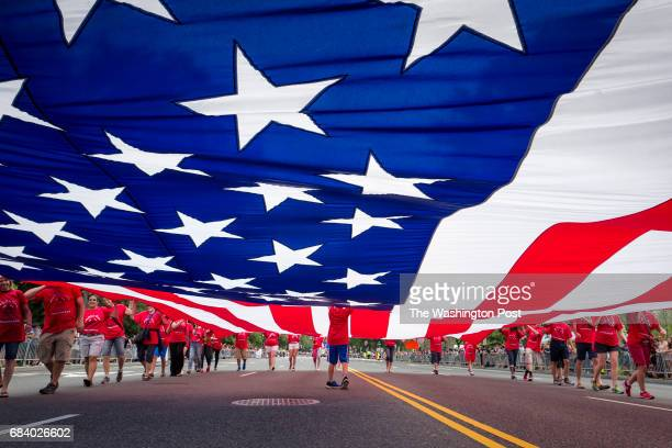 Scenes from the Independence Day Parade on July 04 2015 in Washington DC A massive flag id carried along the route