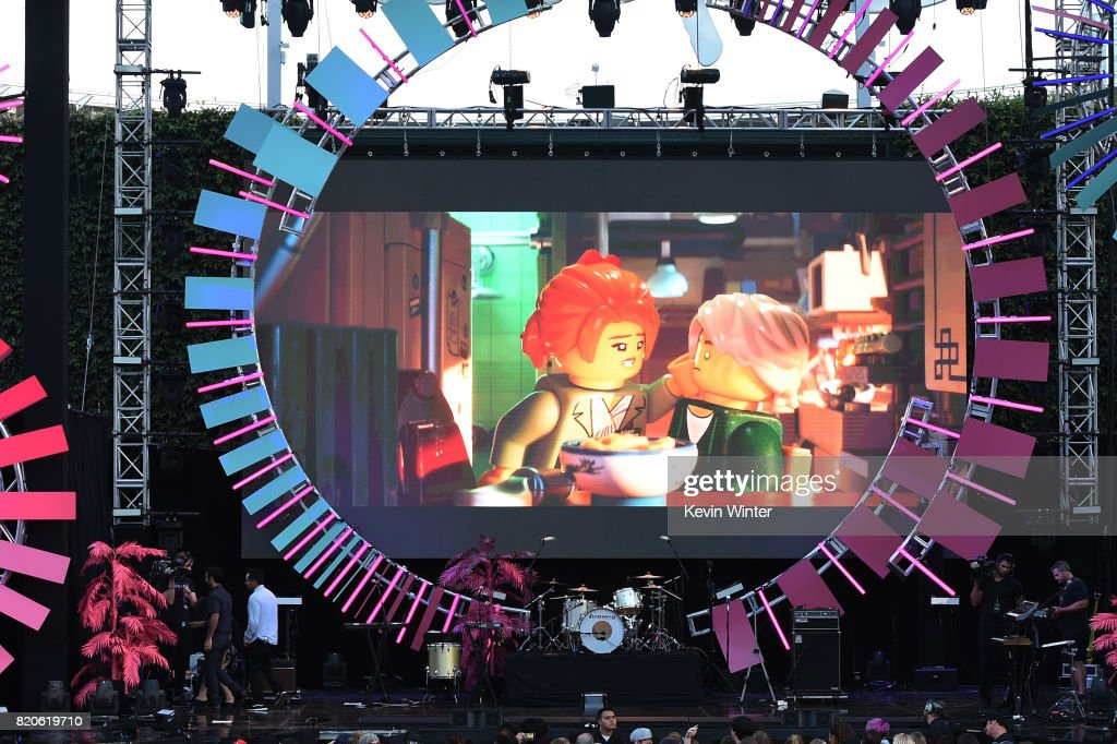 Scenes from 'The LEGO Ninjago Movie' are projected onstage