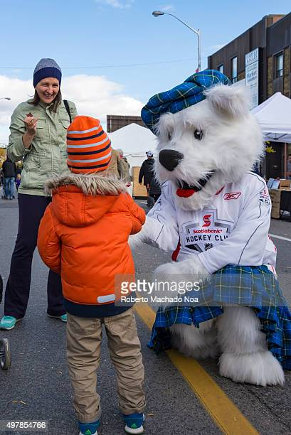 Scenes from TO West Halloween Fest 2015 Children having fun with mascot or man in dog costume Toronto West Halloween Fest at BloorWest Village is a...