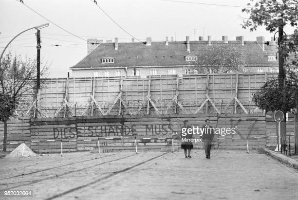 Scenes in Berlin three years after work began on the construction of the Berlin Wall separating East from West West Berlin citizens strolling down a...
