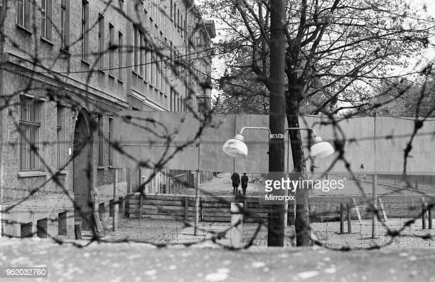 Scenes in Berlin three years after work began on the construction of the Berlin Wall separating East from West Looking over the wall from West Berlin...
