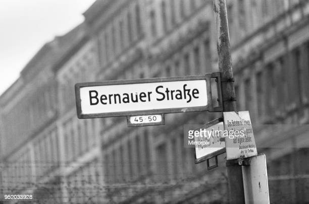 Scenes in Berlin three years after work began on the construction of the Berlin Wall separating East from West Signpost for Bernauer Strasse a street...