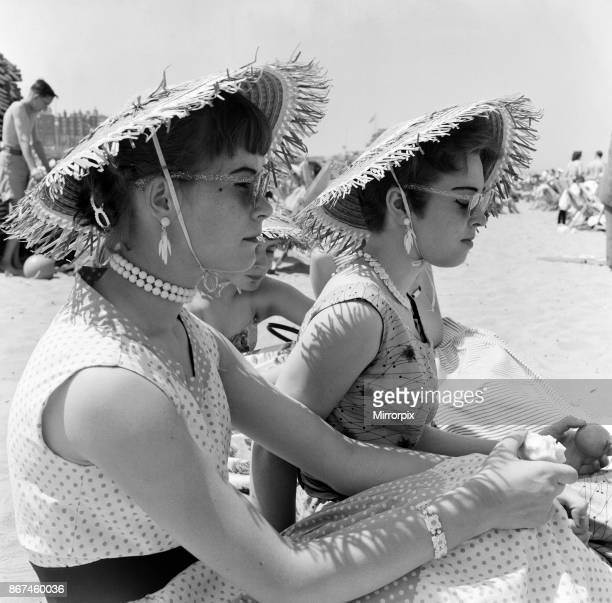 Scenes in Margate during a heatwave Today's beach fashion straw hats necklaces and earrings Left 16 year old Anne Dear a London copytypist of Lee and...