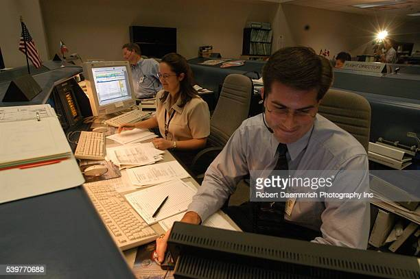 Scenes in the active Mission Control Center where flight controllers are monitor the International Space Station mission NASA held handson...