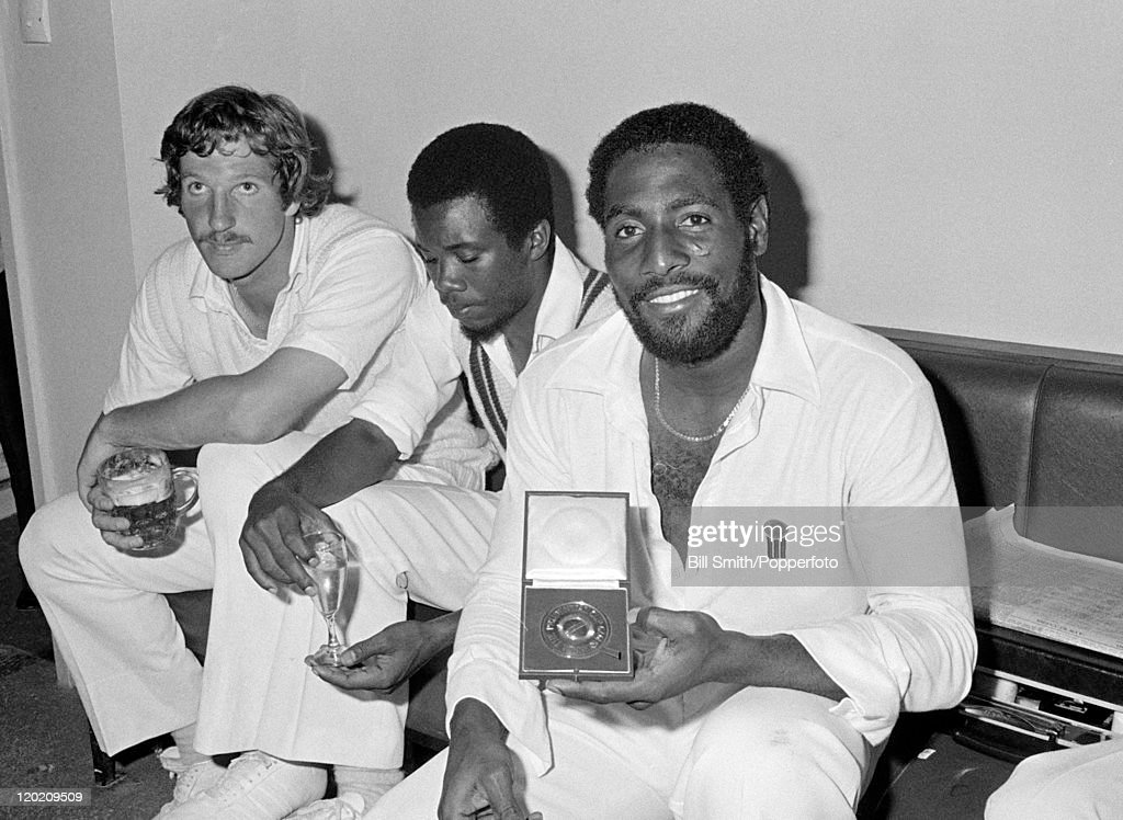 Scenes in the West Indies dressing room after their victory over England in the World Cup Final at Lord's cricket ground in London, 23rd June 1979. West Indies won by 92 runs. In this photograph, West Indies all-rounder Viv Richards (right) shows his his Man of the Match award whilst seated next to Malcolm Marshall and England's Ian Botham who is holding a pint of beer (left).