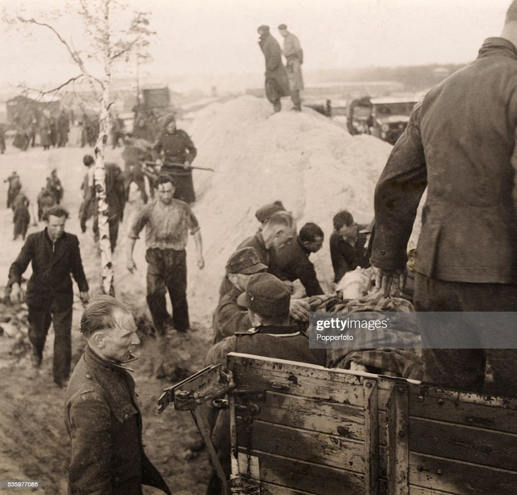 Scenes inside Belsen Concentration camp after it was liberated by British troops, 15th April 1945. The Royal Army Medical Corps, number 11 Light Field Ambulance Brigade, and the 67 Coy American Field Service Unit were tasked with clearing the Belsen Concentration Camp. Brigadier Llewellyn Glyn-Hughes, who was put in charge of cleaning up the camp, said it took a staff of 68 a fortnight to stamp out typhus in the camp. But prisoners too sick to respond to treatment continued to die. The last hut in the camp was burned to the ground on 21st May 1945. The camp commandant, Josef Kramer, was found guilty at Luneberg of war crimes and hanged in December 1945. Today the camp is a landscaped park.